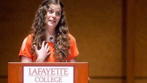 "MacKnight Black Poetry Competition winner Michele Tallarita '12 reads her poem titled ""Hotel U"" at the Williams Center for the Arts."